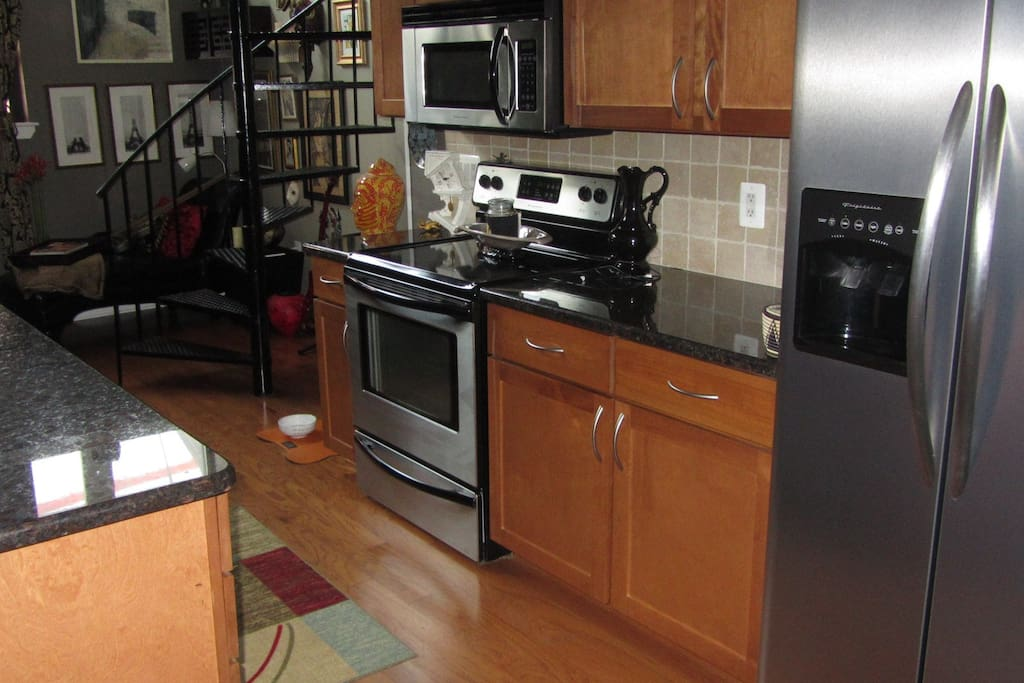 Full kitchen with range, microwave and dishwasher