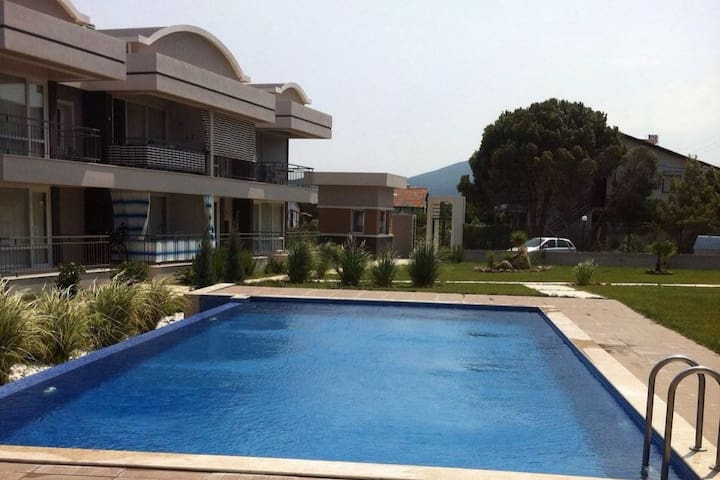 APARTMENT IN GULBAHCE WITH POOL AND SEAVIEW