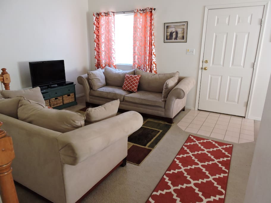 Cozy livingroom area with large TV