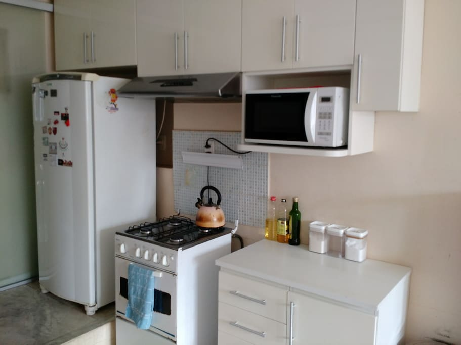 Kitchen Stove, Refrigerator and Cabinets