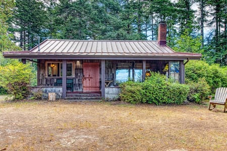 Beautifully restored lakefront cabin on five acres with canoe and dock!