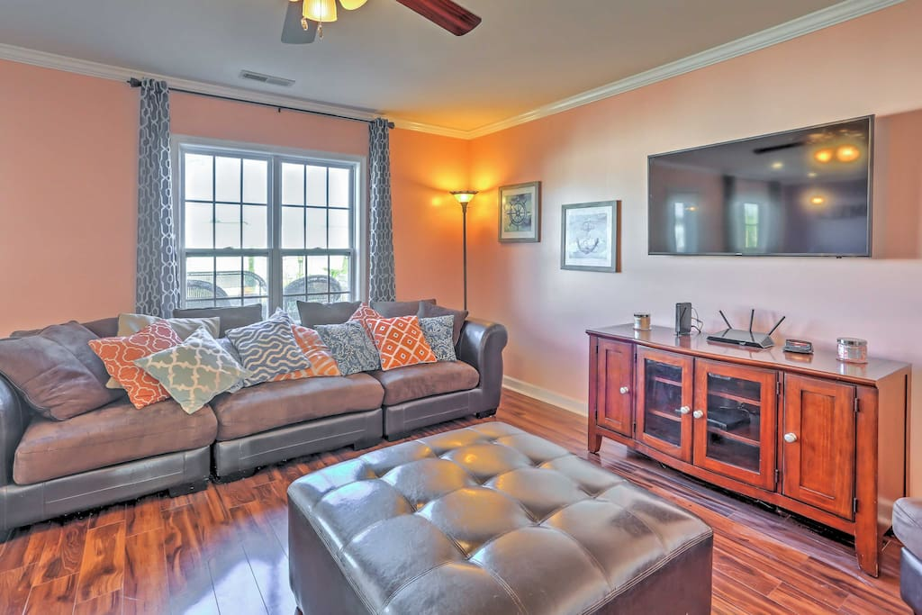 The plush couches in the living area provide a great place to relax while watching TV.