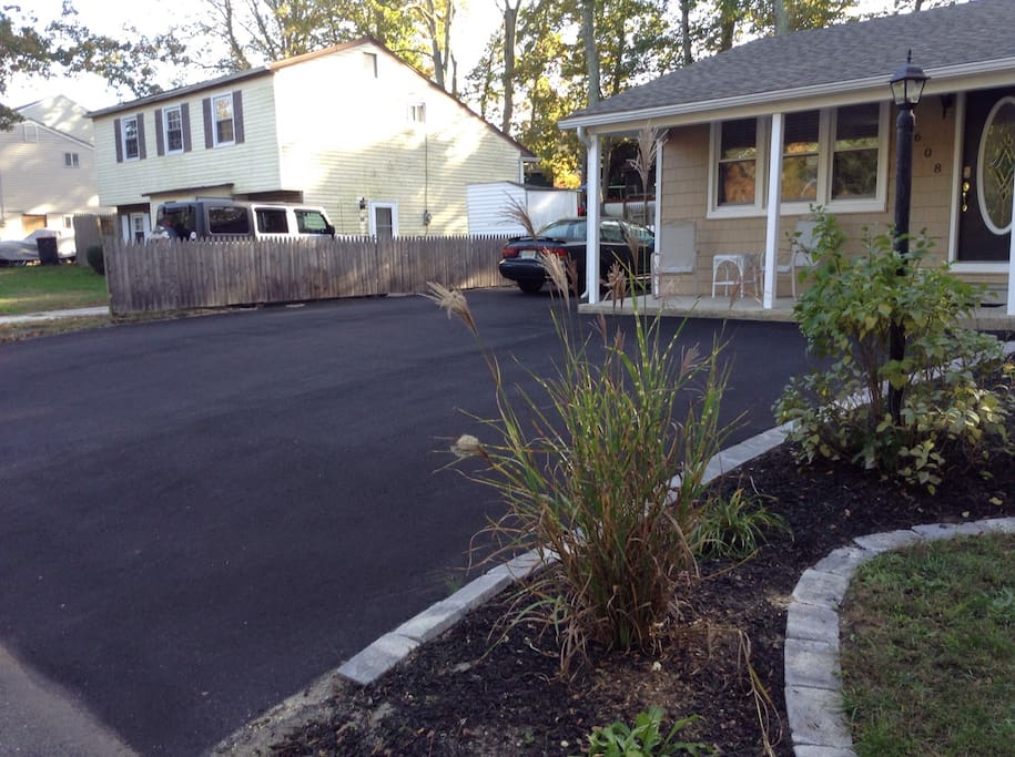 This newly asphalt paved driveway can accommodate up to  5 cars.