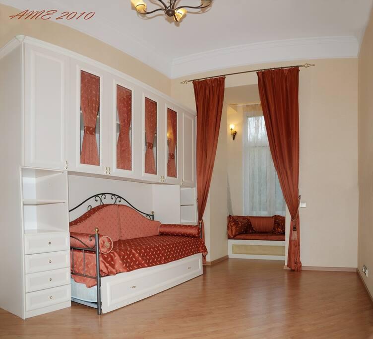 Bedroom # 2 w/loft and Bay Window seating.