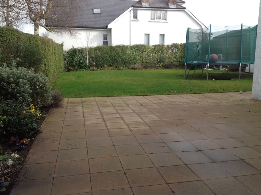Large patio area and lawn to relax on