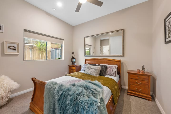 Well-separated 2nd bedroom with ceiling fan and direct bathroomaccess