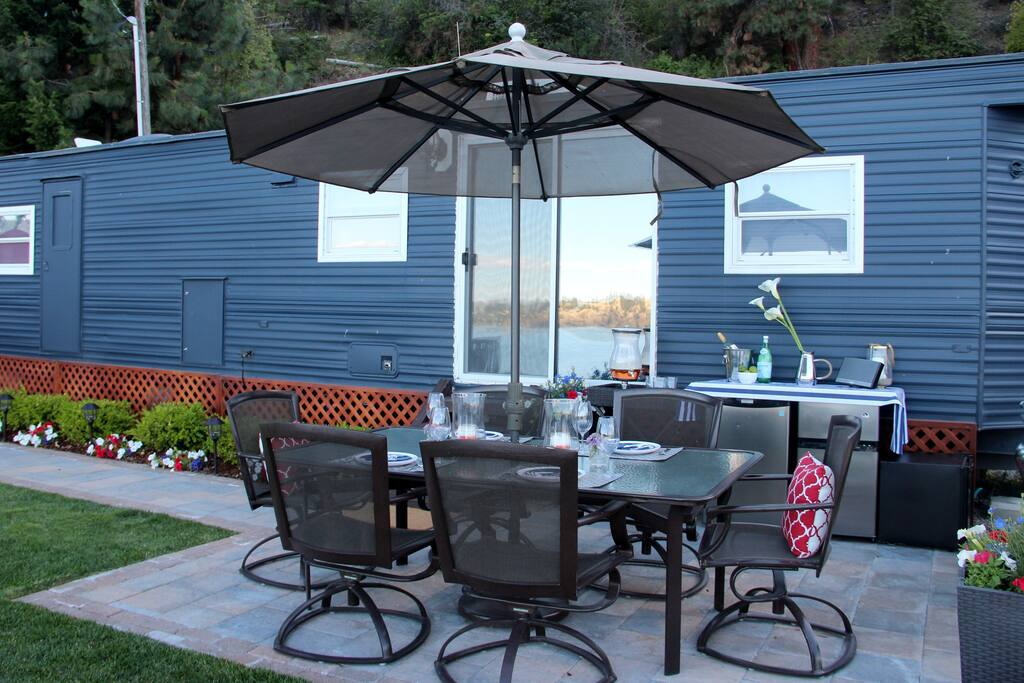 Looking at our luxury trailer and outdoor eating area...