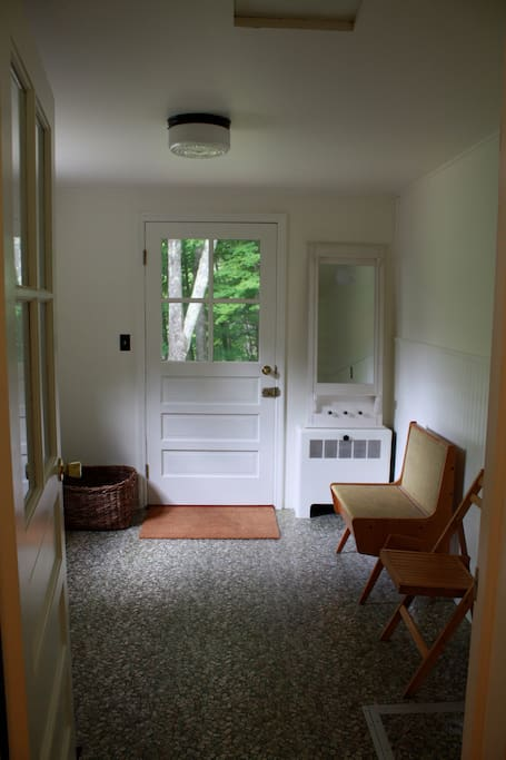 Mudroom entry with plenty of room to take off your muddy shoes and hang up your coats.