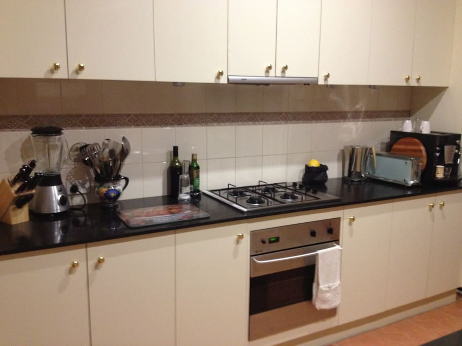Modern, spacious kitchen is fully equipped