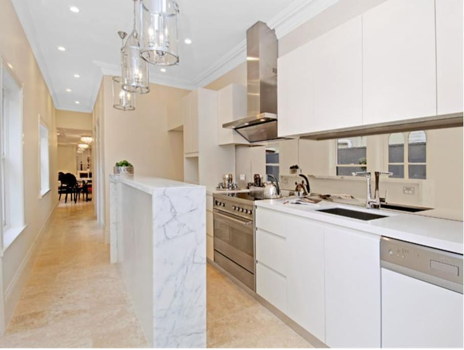 Modern kitchen with latest finishes including coffee machine, filtered cold water, speaker system