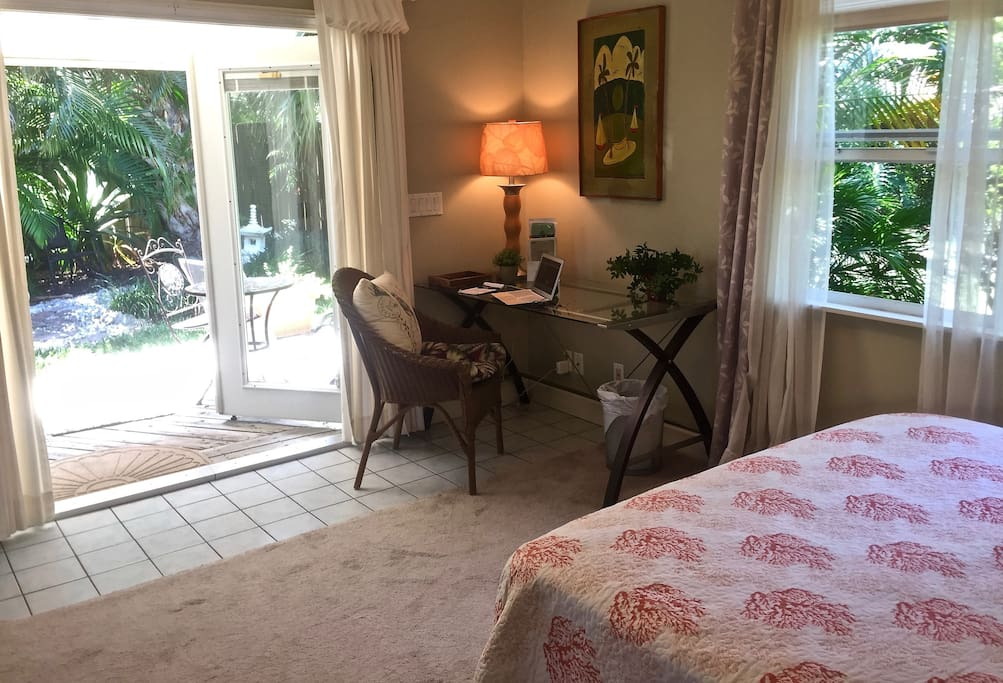 Main Bedroom w French doors & private deck overlooking the pond & gardens.