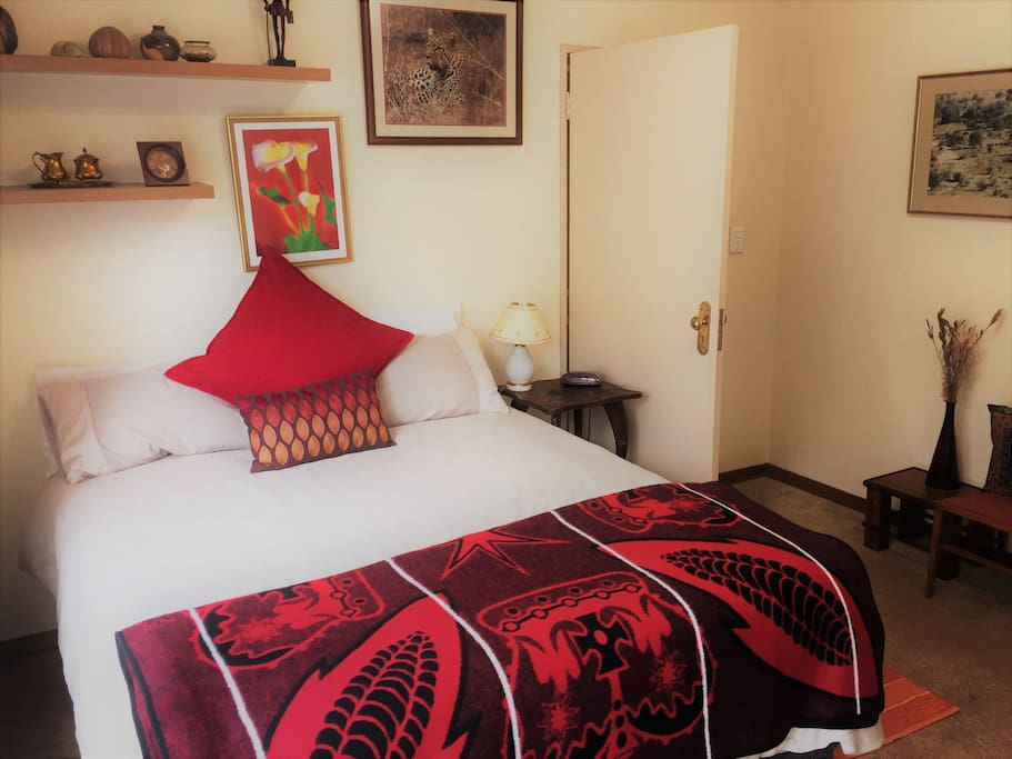 The Main Bedroom has a Queen-sized bed and is tastefully furnished.