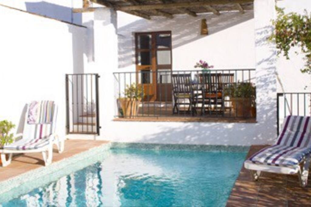 The private swimming pool, also showing the downstairs terrace.