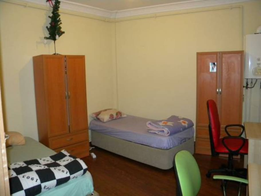 Room with two single beds.