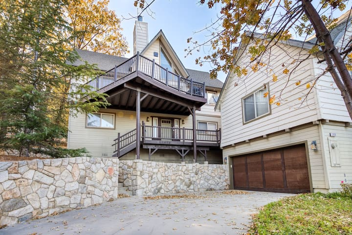 Beautiful home with fireplace, mountain views, and spacious deck