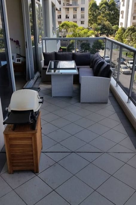 Oversized balcony with Weber barbecue and outdoor furniture suite. Perfect for al fresco dining!!.