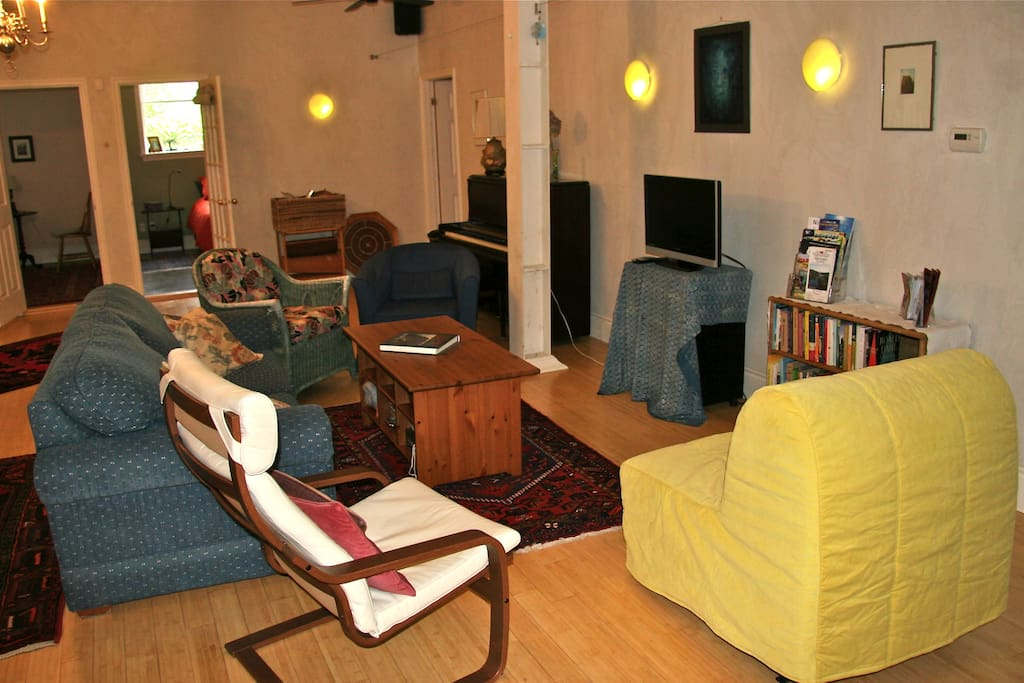 The living room area with piano, TV (a HMDI hookup, DVDs, books, games in table cubbies.