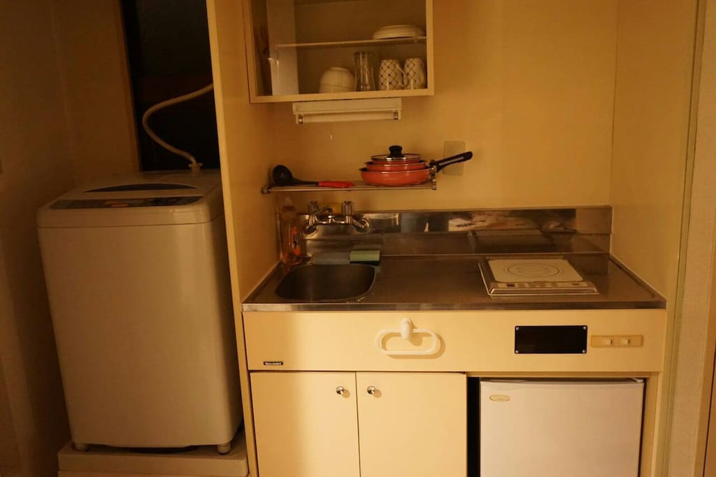 small kitchen with frying pan, pots, microwave, fridge. you can cook a easy cooking.