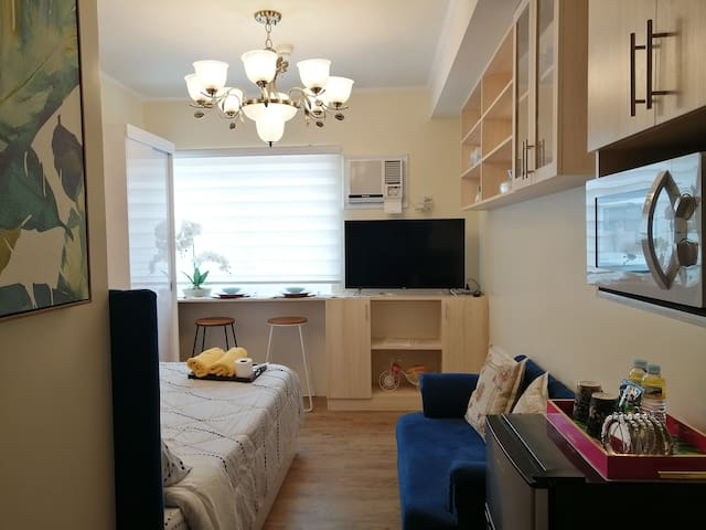 255 Furnished Studio with NETFLIX, near Nuvali