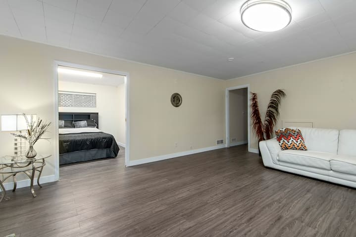 Bedroom 1 of 2 accessible from Living Room. Sliding Door provides privacy from Living Room.