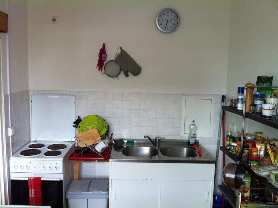 Kitchen with big fridge & dishwasher