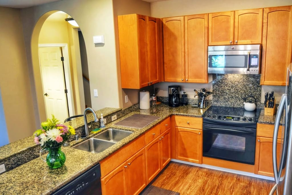 Large kitchen equipped with all the appliances and utensils.