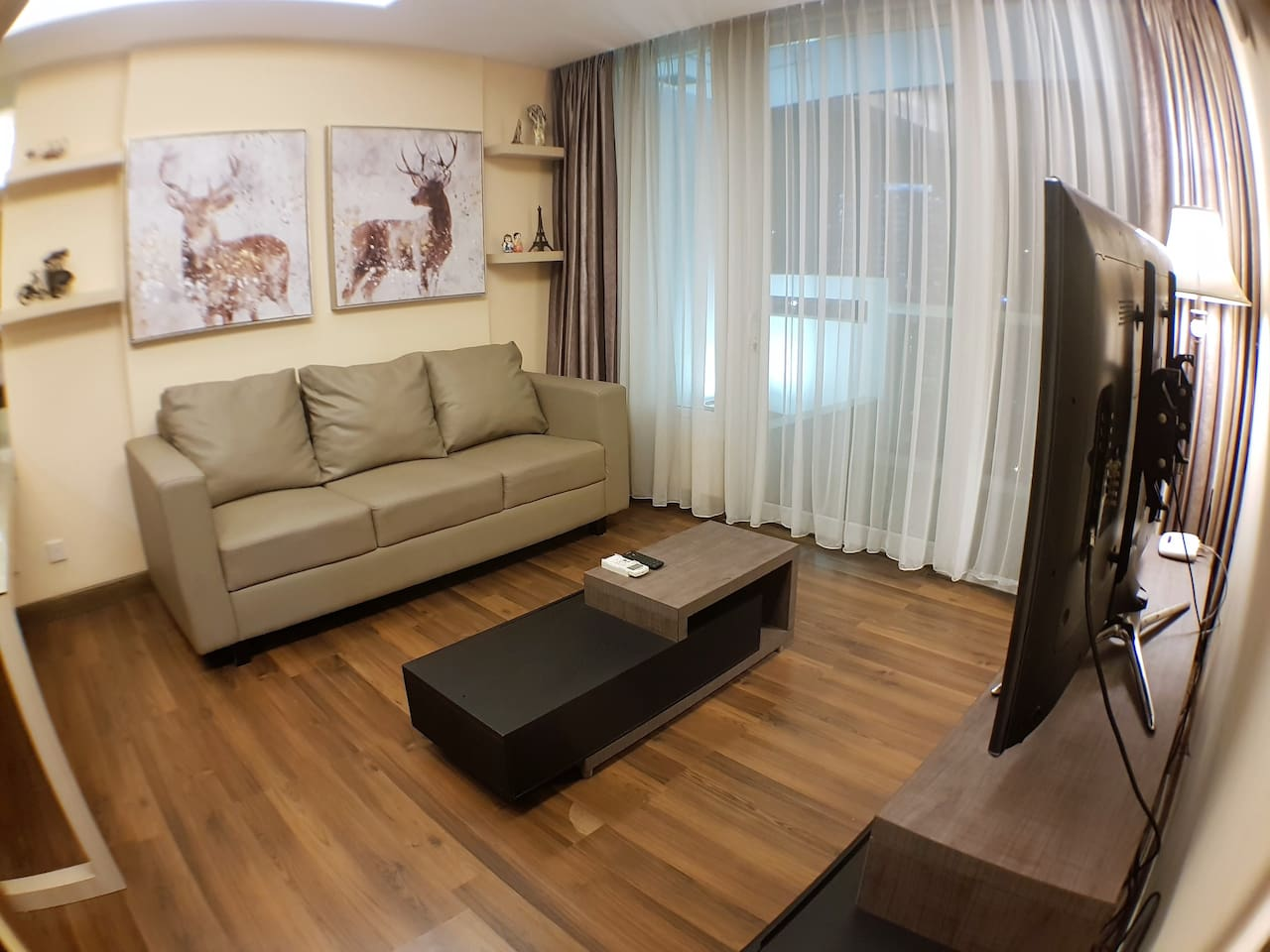 """Living Room with Smart LED TV 55"""" with more than 65 channel such as AXN, Star World, History, HBO, Fox TV,National Geography, Discovery, Fashion TV, CNN, CNBC etc  for your entertainment."""