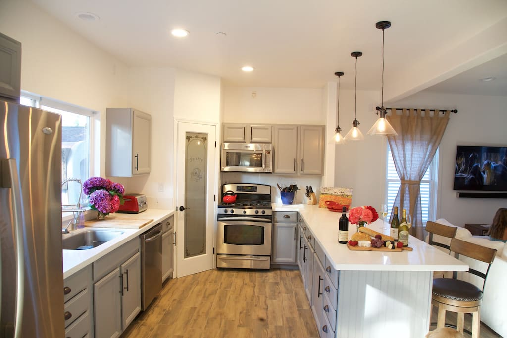 Stocked Kitchen, Gas Range, pantry, Microwave, seats 4 with Counter Top Stools.