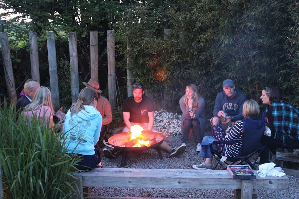Guests enjoying a sociable time around the open fire pit
