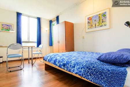 "Summary: This room on the 3e floor (no flat) in a quite area is easy to get to from airport Schiphol, Close to stop busline ""Eurolines"". The metro brings you in 12 minutes to the centre. Free parking place. Breakfast included."