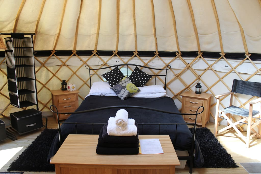 Inside one of our luxury yurts.  Comfy king sized beds, crisp white bedlinen and all towels provided.