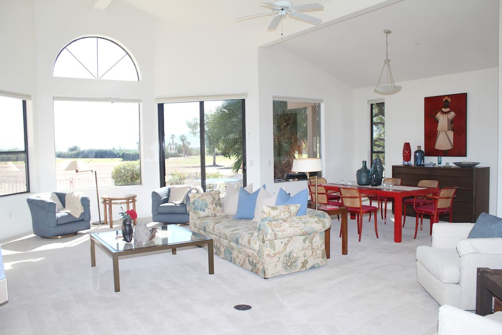 Vaulted ceilings and tasteful artwork lead into the open living room