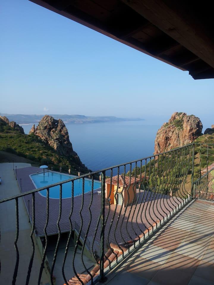 The panoramic view of the mediterranean sea from the veranda. Tanca Piras Villaggio, Nebida, Sardinia.