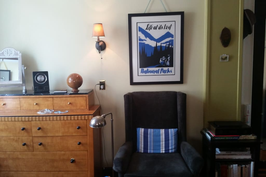 Sitting area and chest of drawers. Unit entry to the right of the chair