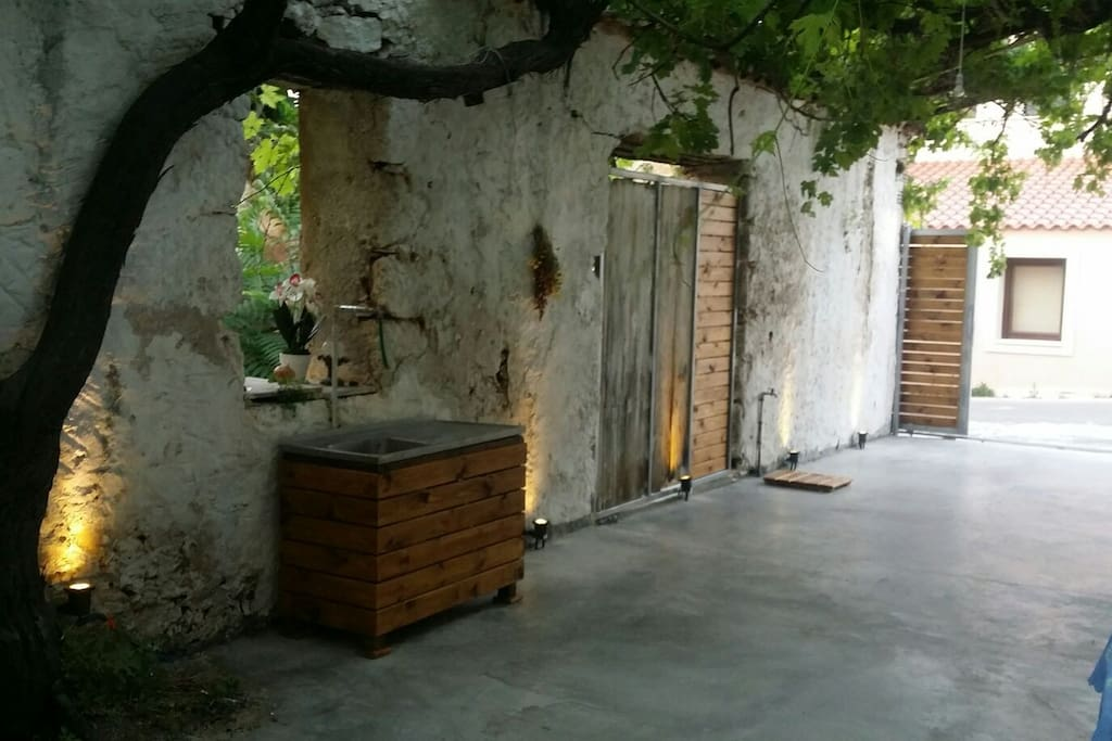 outside kitchen and shower-opened gate