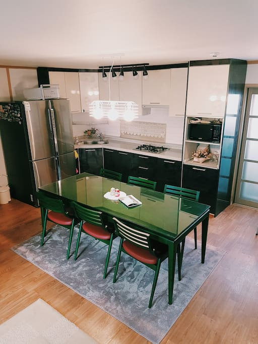 Large dining table with modern kitchen facilities!