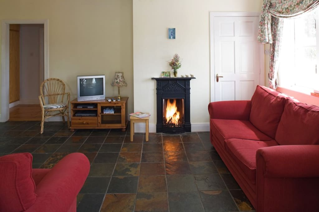 The living room in the cottage has an open fire, WIFI and satellite TV