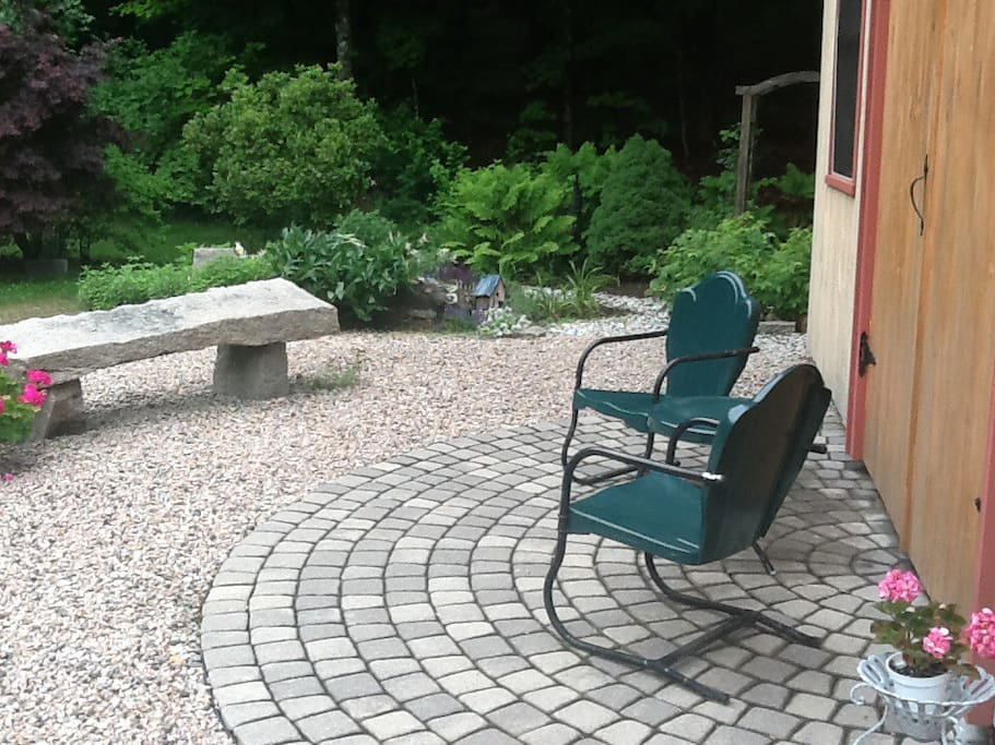 The real-retro garden chairs and granite bench await your arrival.