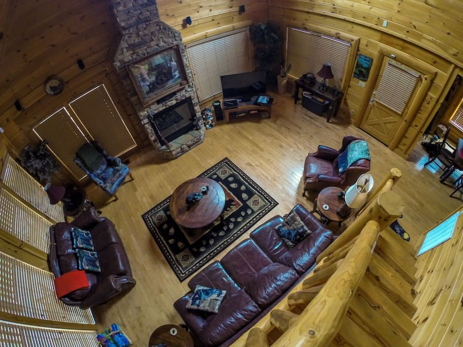 """Upscale living room with cozy leather furniture, 50"""" smart tv, and surround sound"""