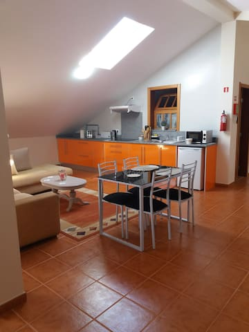 This is the living space with fully equipped kitchen, with all you might need for all meals. Corner sofa where you can relax....