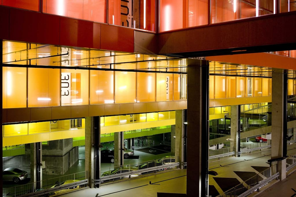 Parking area and the colorful corridors leading to the apartments