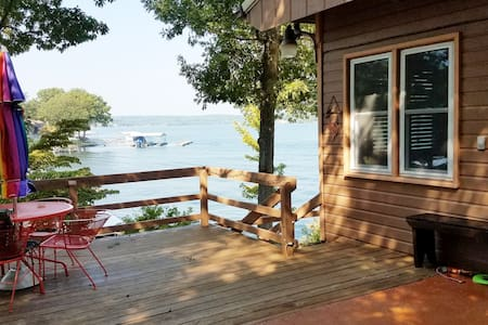 Cozy cabin, dock with slip, great view.