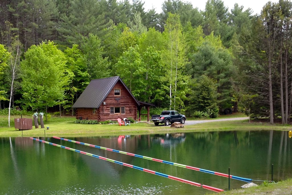 Sits on a pond, surrounded by trees. Roll out of bed and swim some laps
