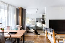 Here you can see the kitchen and my sleeping area. At night I'll close the curtain all around the bed. It gets very dark and comfy for me in there. You'll still have access to the kitchen at all times.  This photo is taken by an official Airbnb professional photographer.