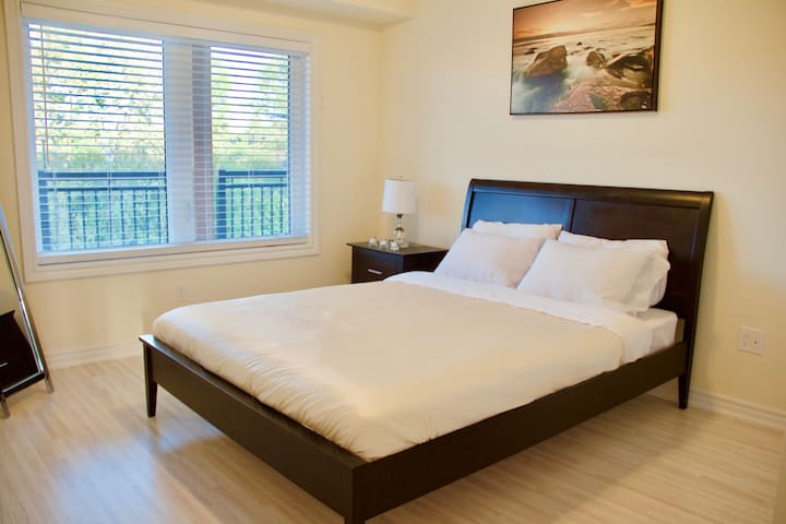 Second bedroom with a queen size bed is located on the first floor.