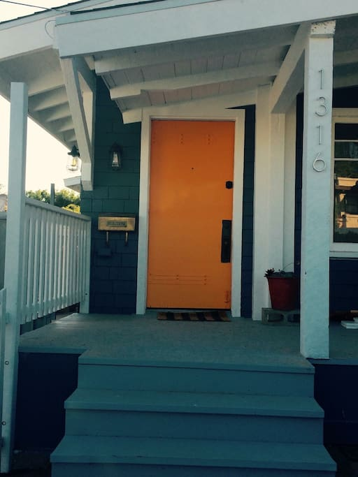 Welcome with our orange door.  Sit on the patio for breakfast and coffee and enjoy the views.