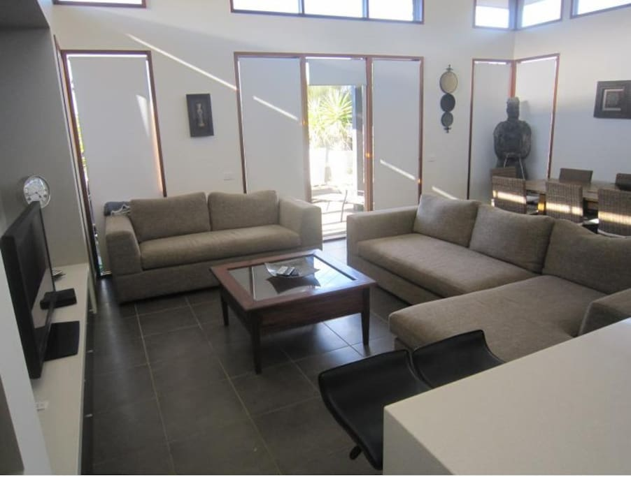 Spacious open plan living area. Couch is fold out sofa bed. TV with DVD and Foxtel