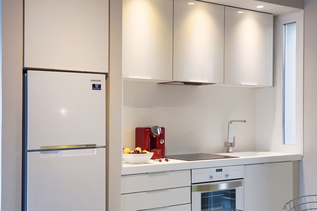 kitchen with Tassimo espresso machine and Corian® solid surfaces