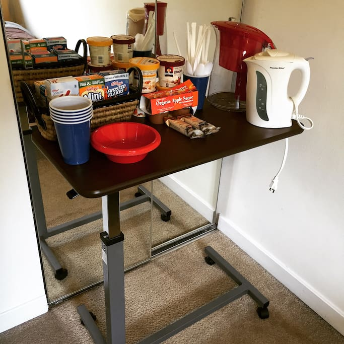 Your room also has a continental breakfast area with a rotating variety of snacks (exact snacks may not be the ones shown in picture). There's also a hot water kettle.