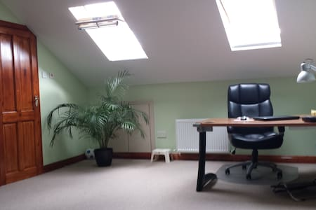 The room are  very spacious with big storage, big computer table and new comfortable sofa bed.Linen is provided. We are near bus and train routes to the city.